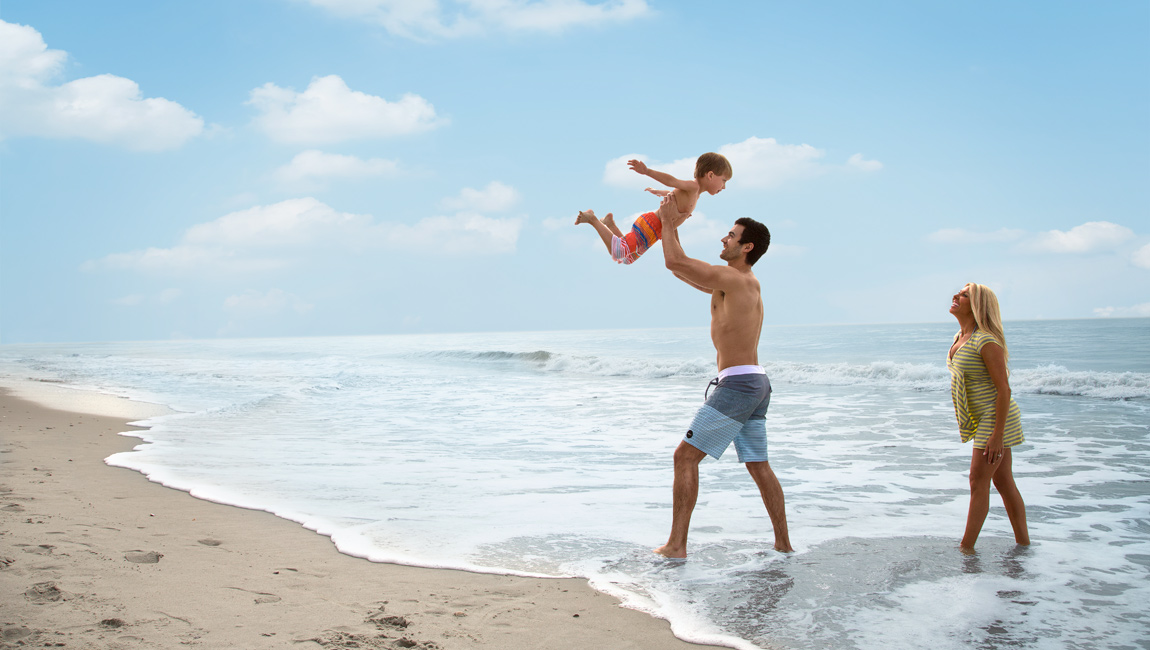 Father holding up son in North Myrtle Beach